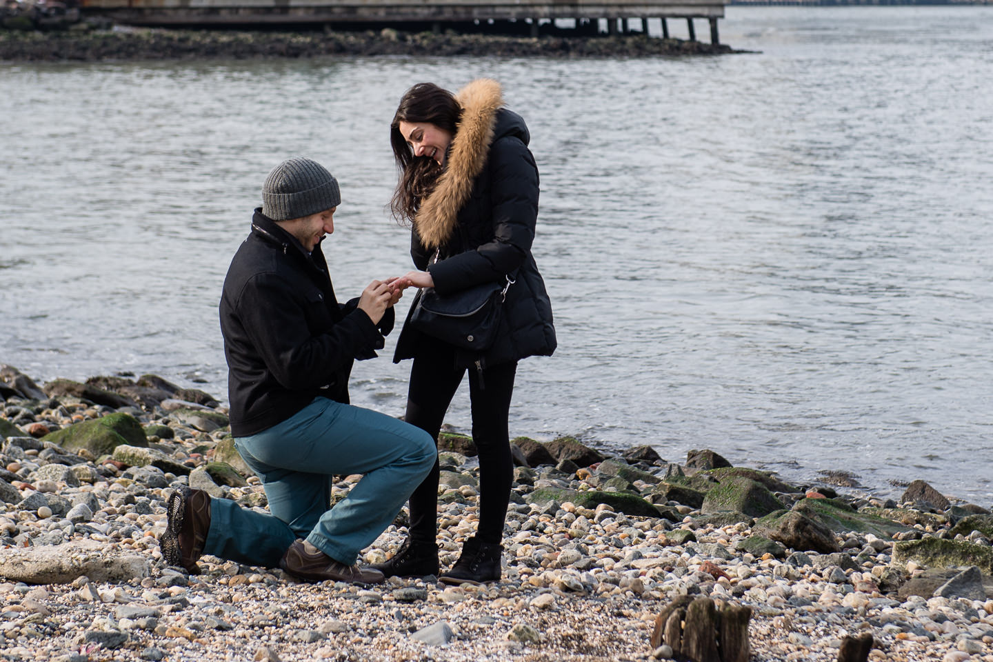 Dumbo, Brooklyn proposal by the water on pebble beach in NYC
