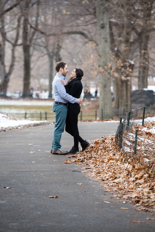 couple hold each other tight in the winter in central park