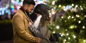 couple is happy and overwhelmed after their proposal at rockefeller center