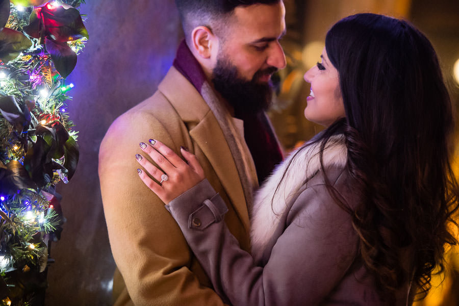 engagement session near the rockefeller center store displays and chrismas lights