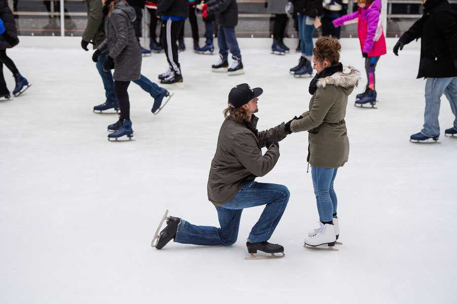 boy proposes to girlfriend on the ice skating rink at rockefeller center