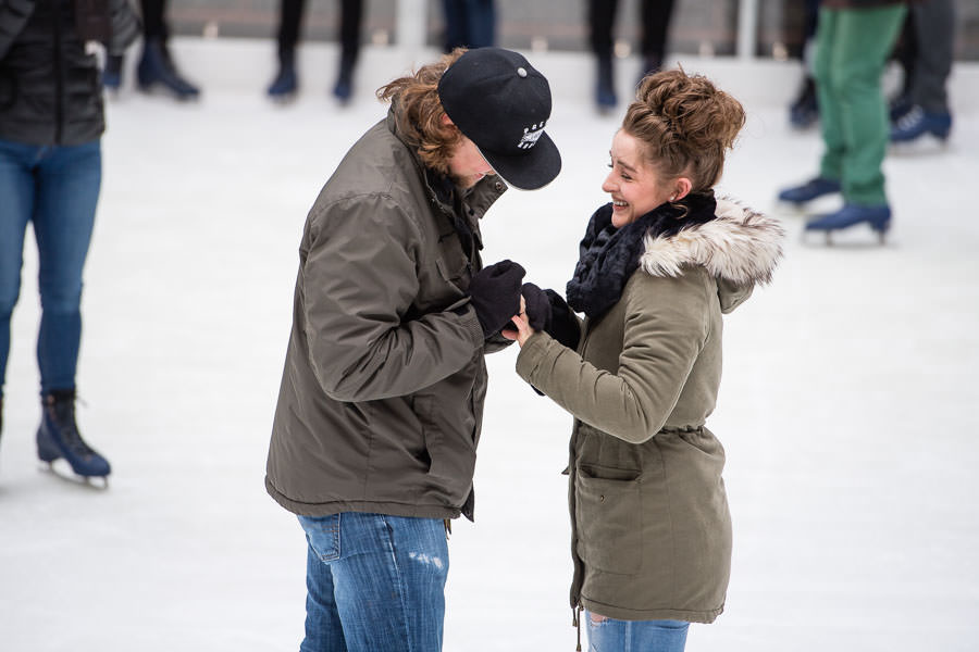 girl is happy while receiving engagement ring at rockefeller center proposal