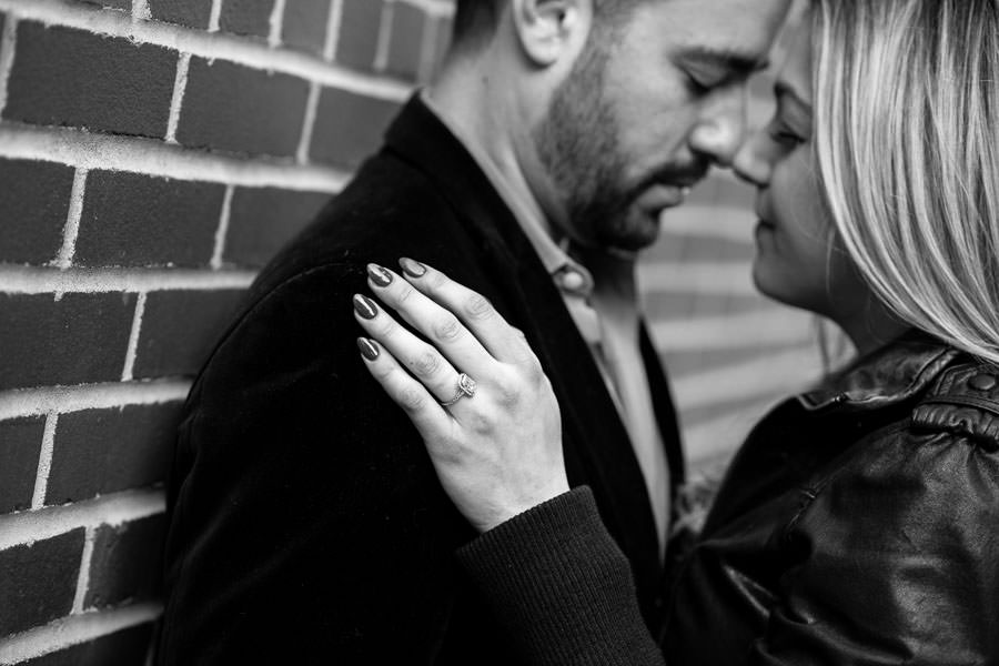 couple romantic with engagement ring close up during photo session in meatpacking district
