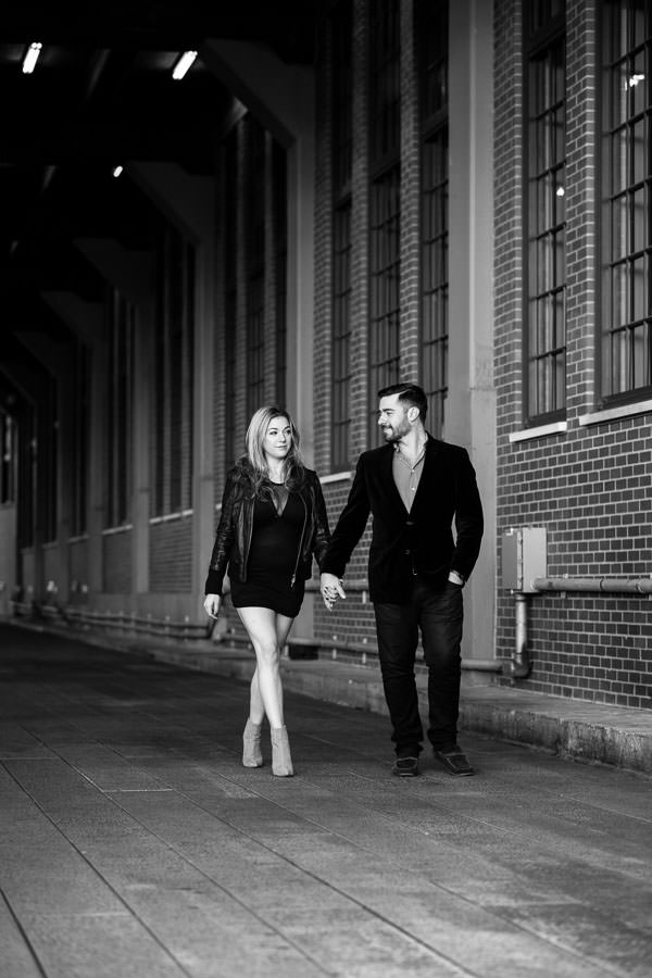 engaged couple holding hands during their engagement session at highline park in nyc