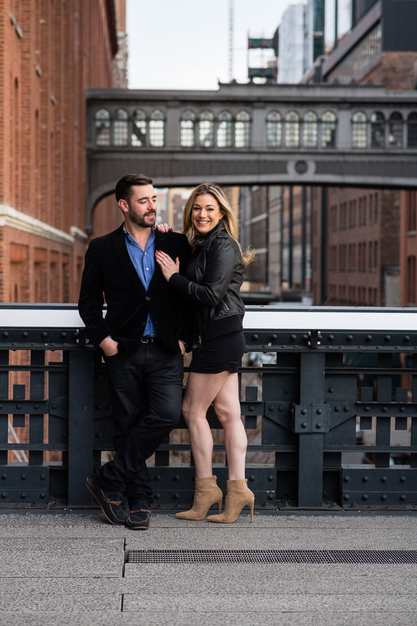 couple hold each other for their engagement session at highline park