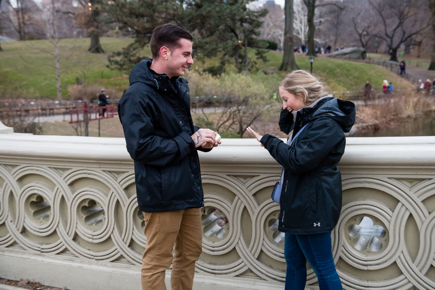 girl is amazed at engagement ring after proposal on bow bridge in central park nyc