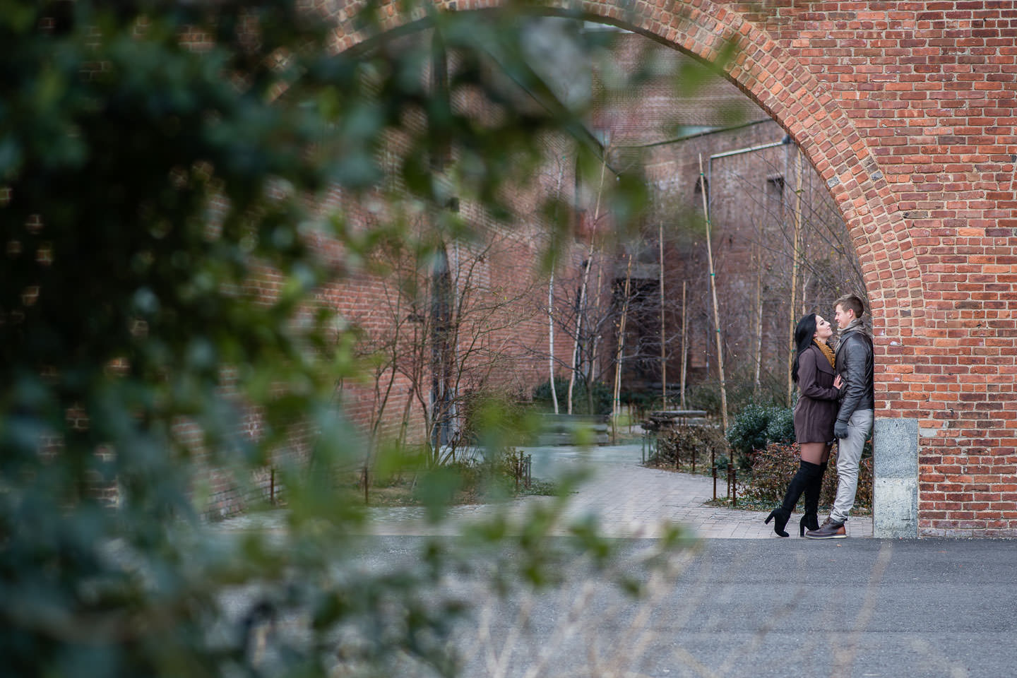 engagement session under archway in dumbo, brooklyn