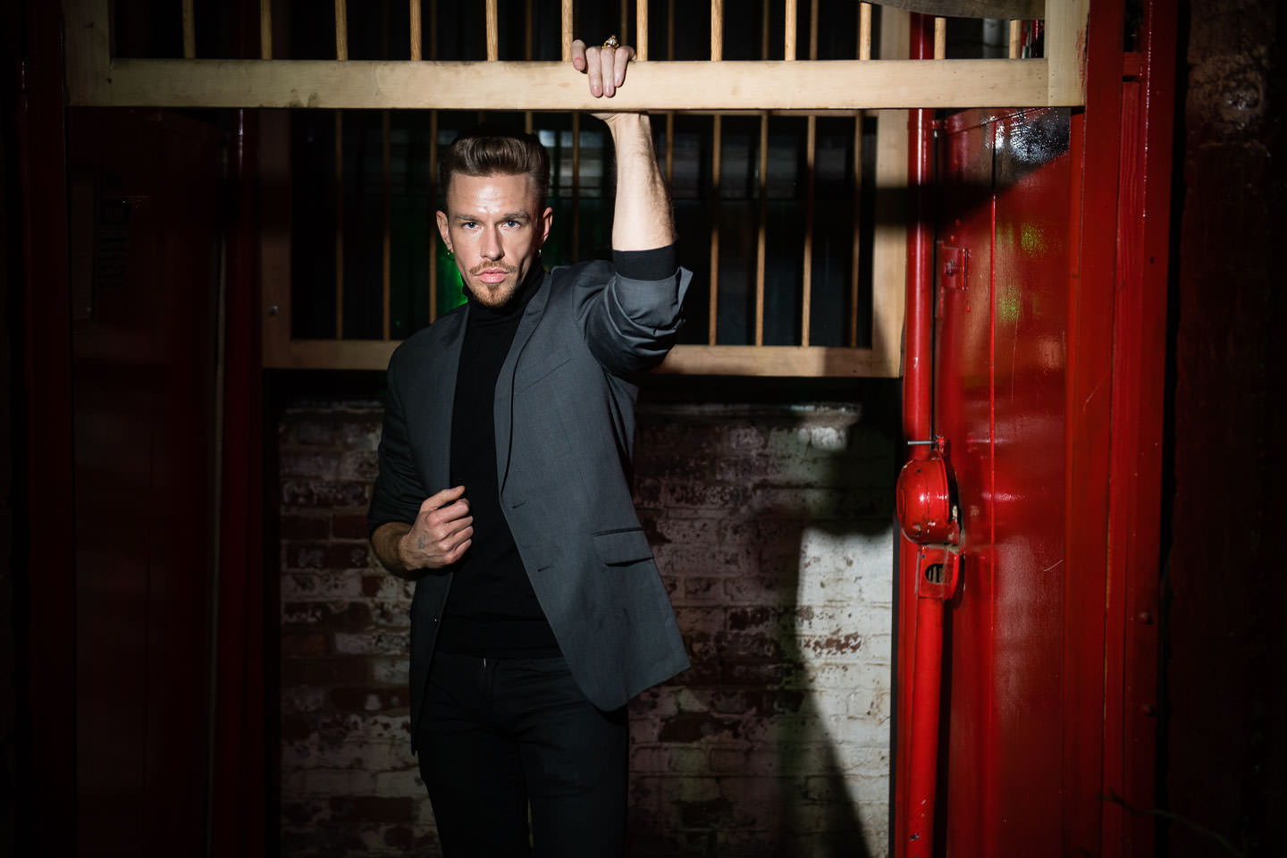 male model poses in freight elevator at monaliza studios