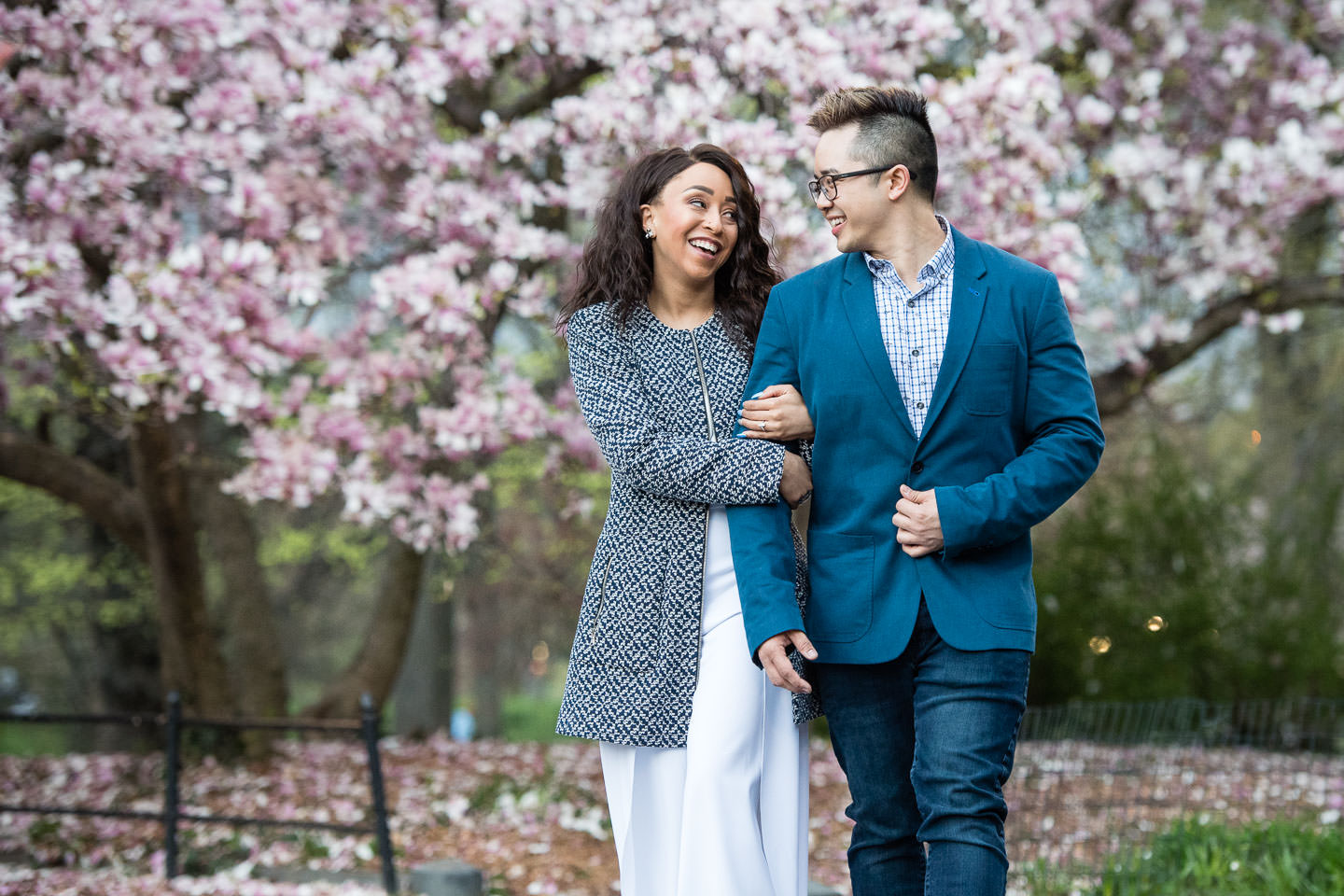 engagement session during spring in central park with japanese cherry blossoms