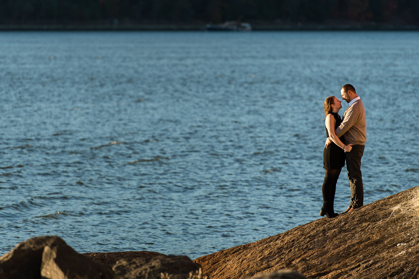 couple holds each other with hudson river in the background at riverside state park