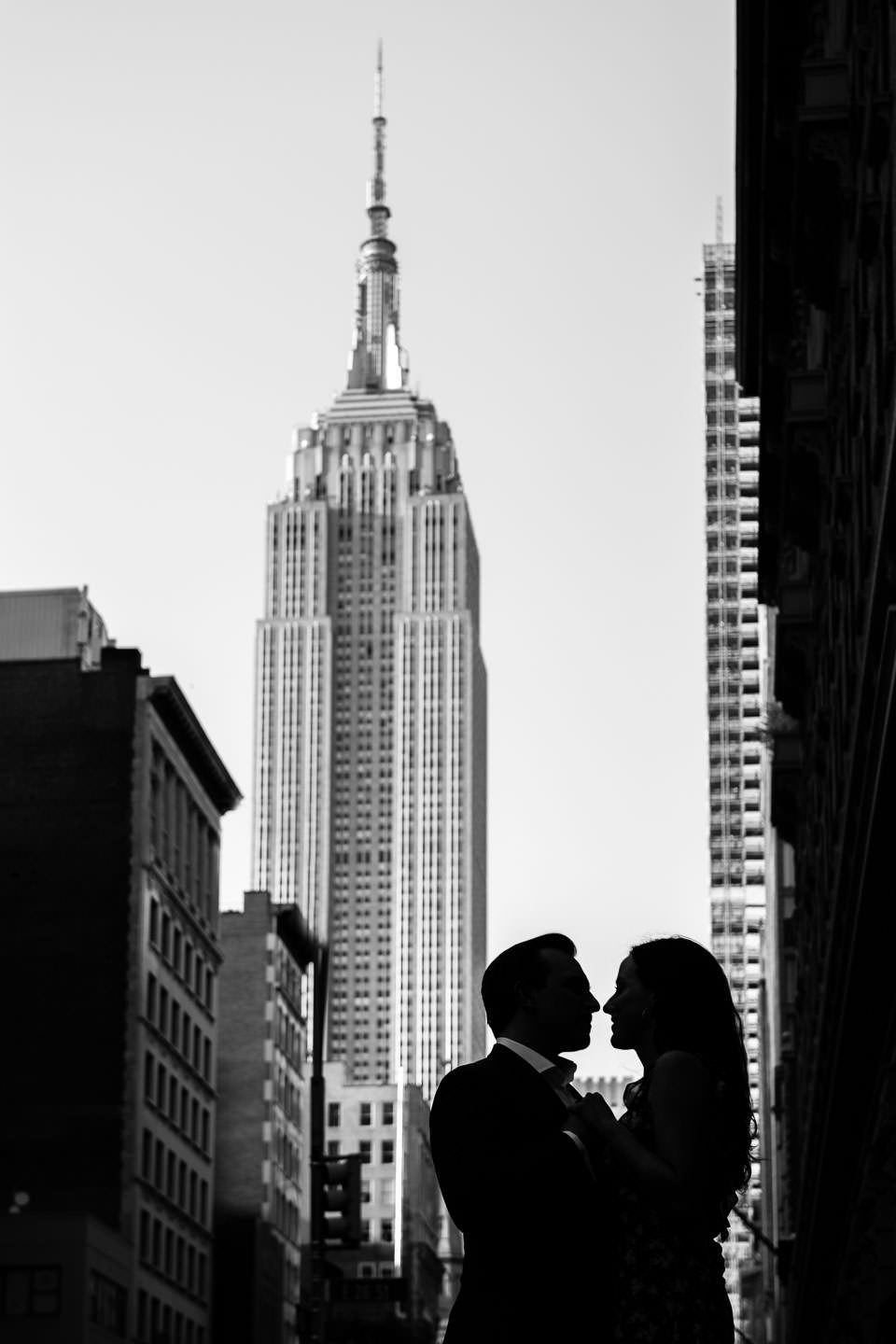 silhouette of couple with empire state building in the background