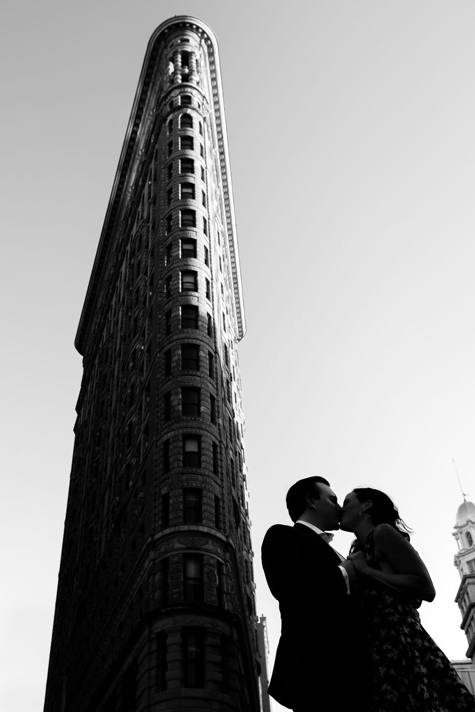 silhouette of couple with the flatiron building in the background