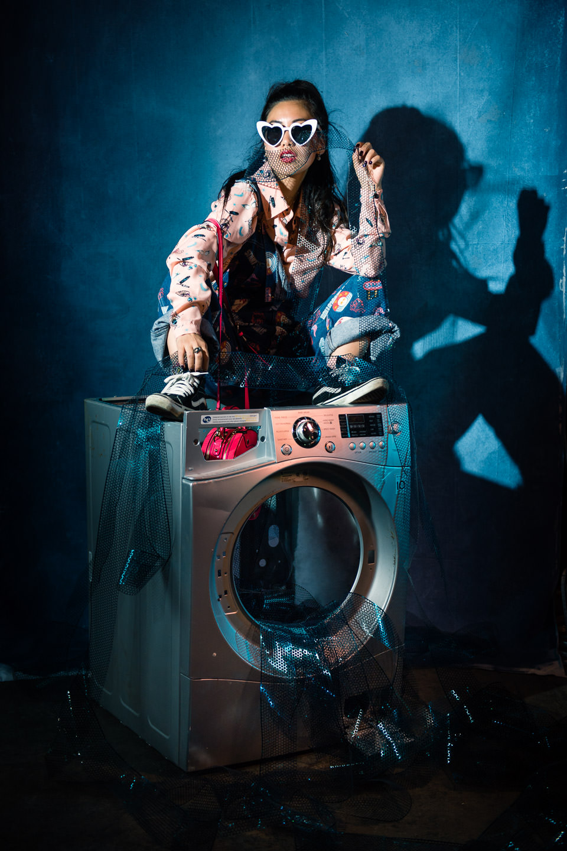 asian model sitting on laundromat