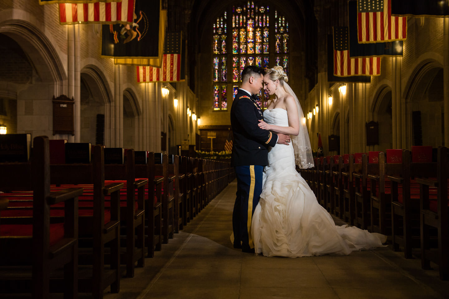 bride and groom at westpoint chapel in west point military academy wedding