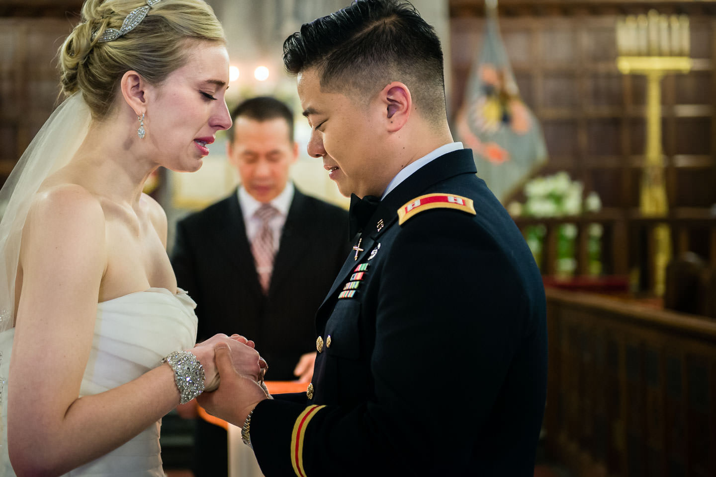 bride and groom cry emotionally during wedding ceremony at west point military academy