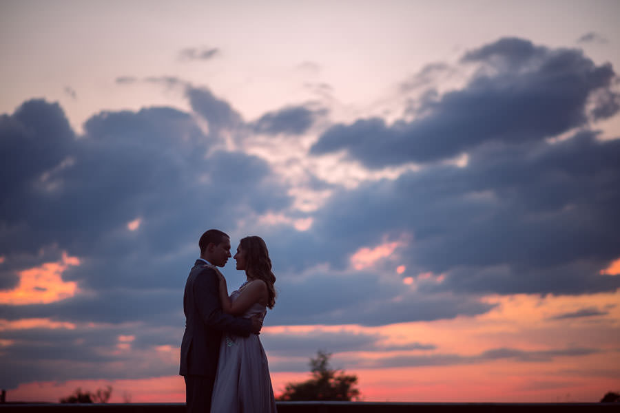 couple dancing into the sunset at their fire island engagement session