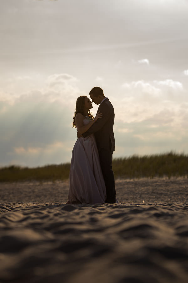 couple on fire island beach for engagement session