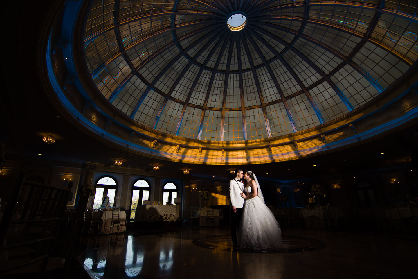couple stands under dome in jericho terrace reception room for their wedding in nyc