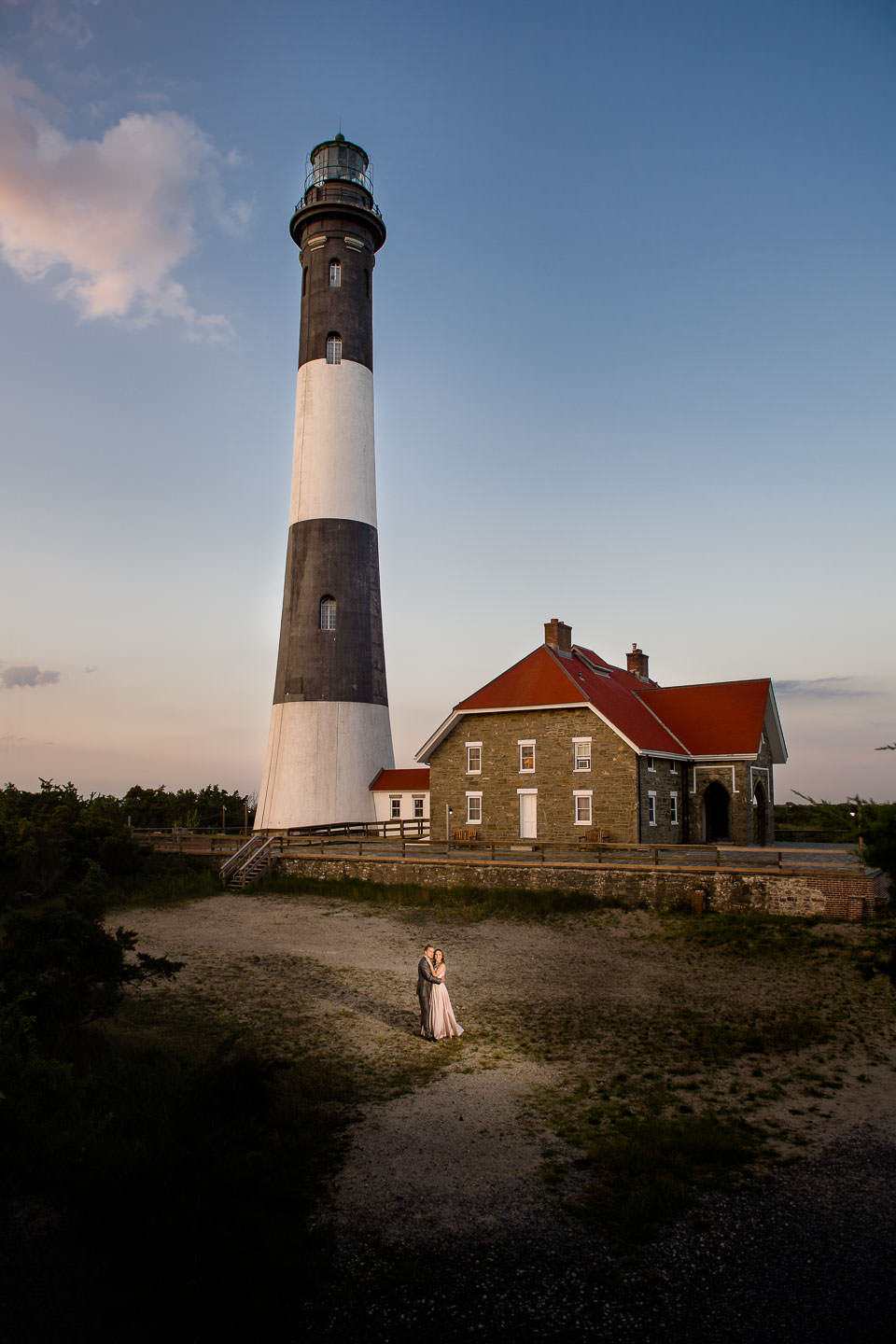 couple engagement session in front of fire island light house