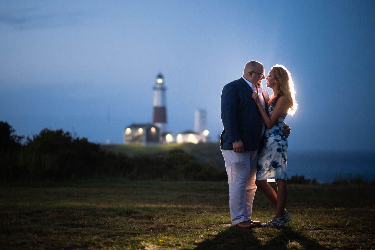 engagement session after sunset by montauk lighthouse with creative lighting