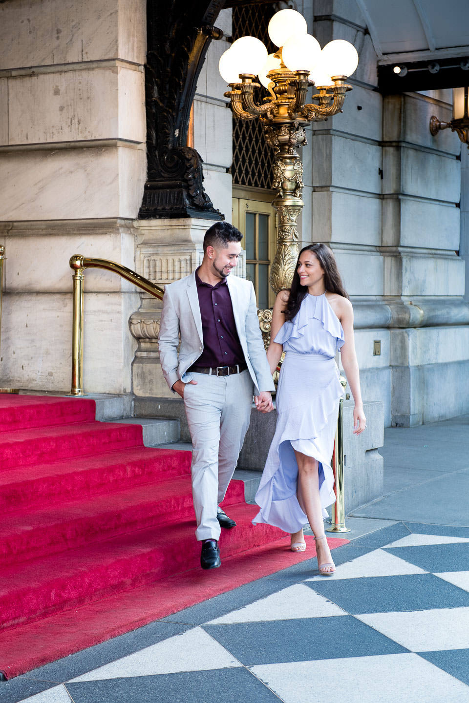 nyc formal engagement session in front of plaza hotel