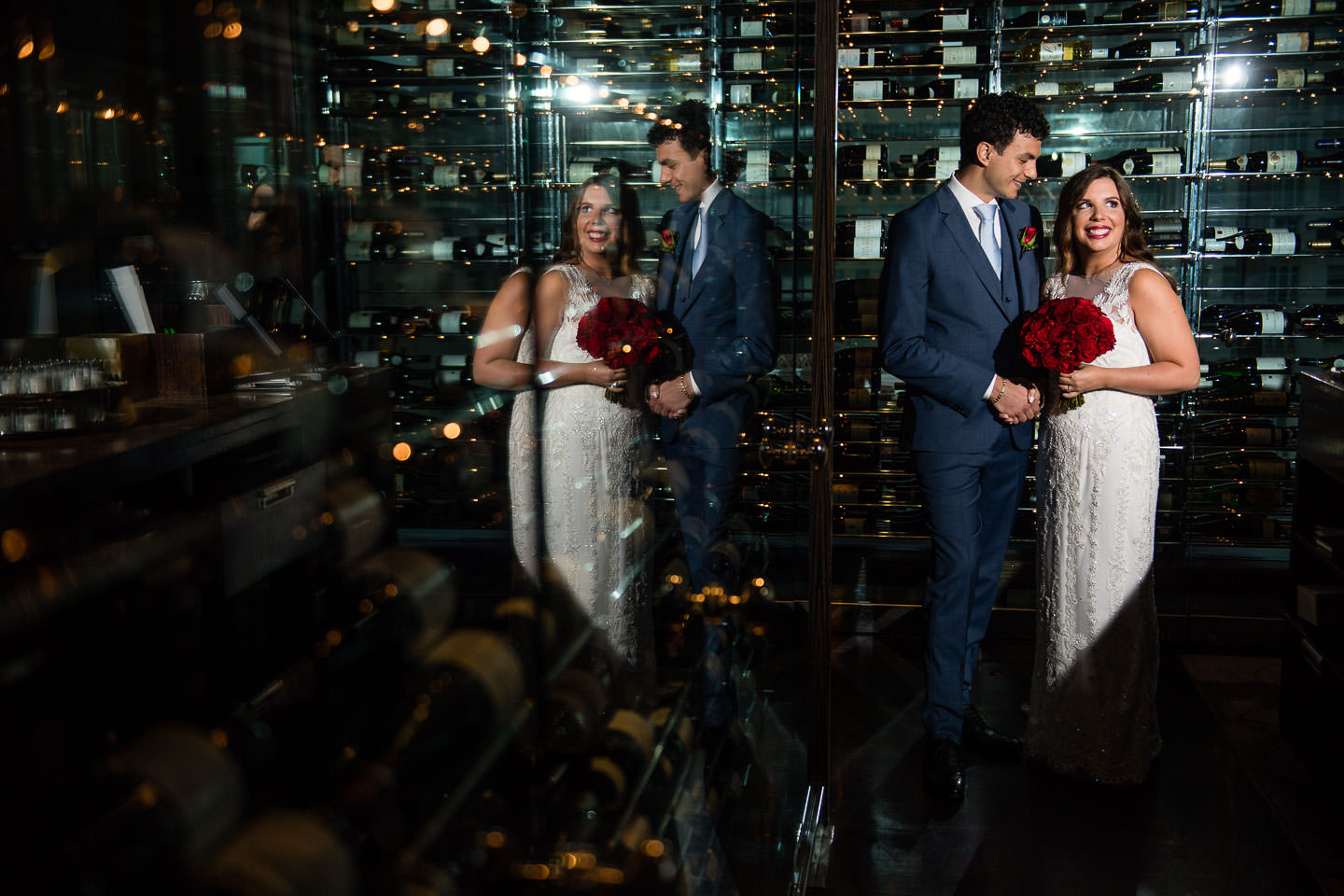 wine wall at mandarin oriental hotel in nyc with wedding couple