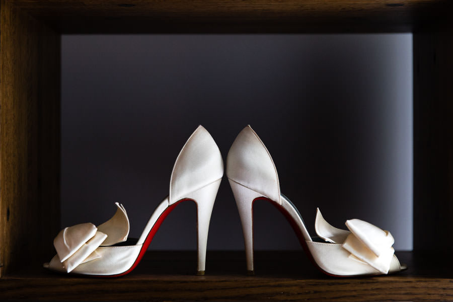white christian louboutin heels with red bottoms for bride on wedding day
