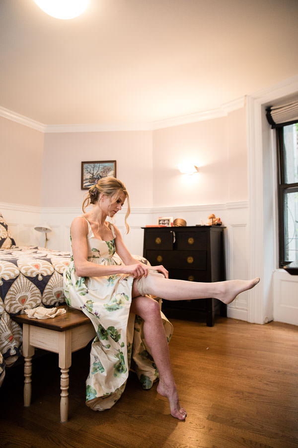 bride getting ready wearing wedding dress in The Time New York Hotel