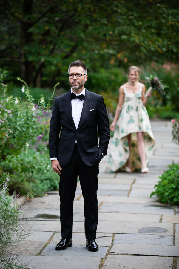 first look of groom and bride in conservatory gardens, central park in nyc