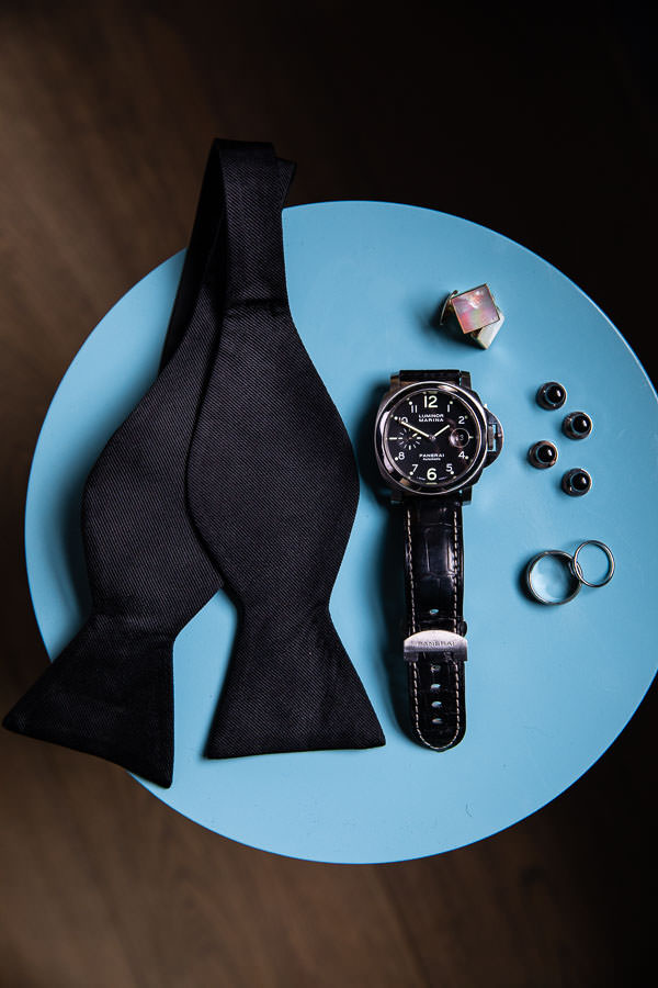 men's wedding accessories such as a panerai watch, rings, and cuff links for wedding day