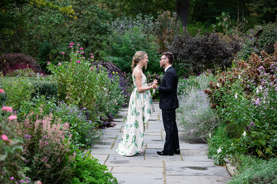 bride and groom embrace each other at conservatory gardens in central park