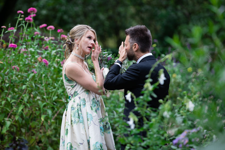emotional reaction of couple in conservatory gardens in central park after first look on wedding in New York City