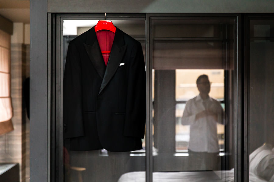men's tuxedo jacket hanging on a hanger at The Time New York Hotel in New York City