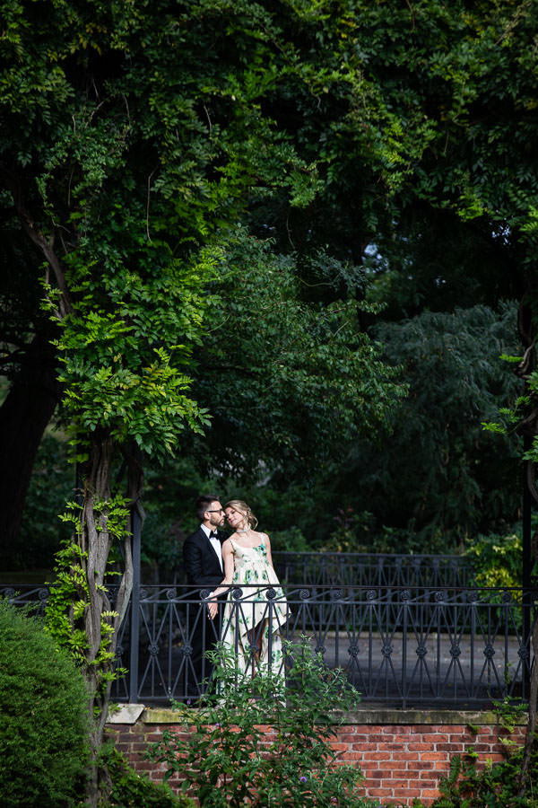 bride and groom pose for wedding photo in central park, new york city
