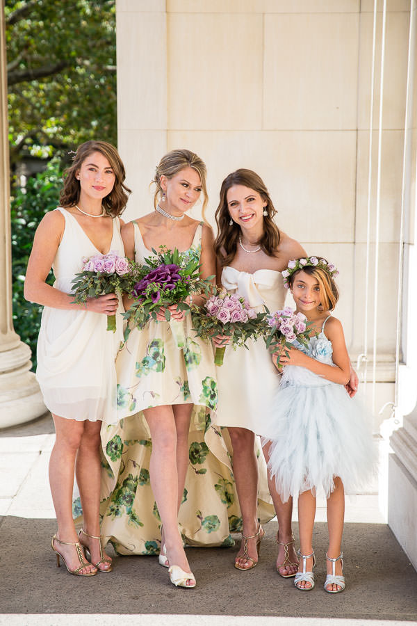 Bride's family posing with bride in wedding dress at nyc wedding photo shoot