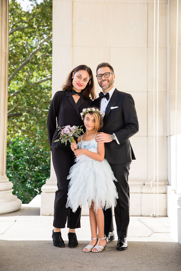 Groom posing with family and child on Columbia University's campus for new york city wedding