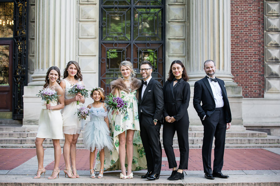 bride and groom with family and friends in new york city at columbia university for new york city wedding
