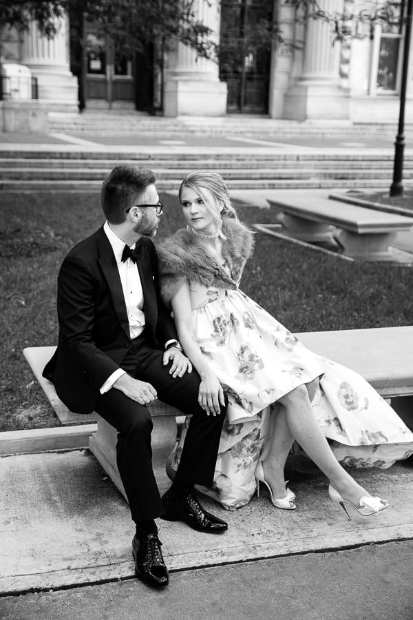 bride and groom sitting on bench for new york city wedding