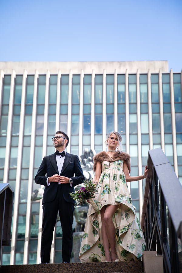 bride in fur stole posing with groom on Columbia University's campus