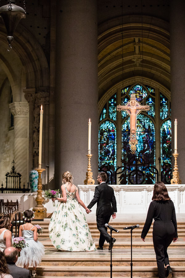 couple on their wedding day on the alter of church for a new york city wedding