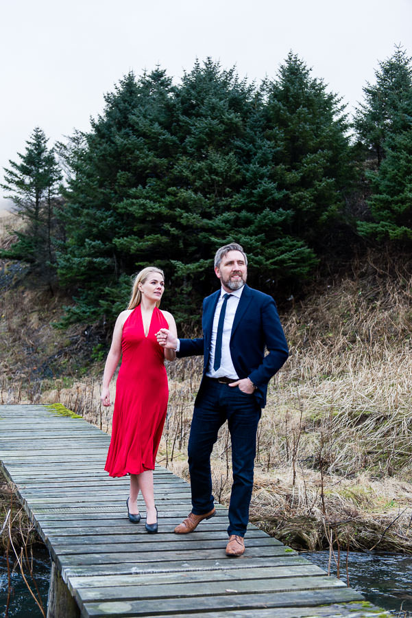 husband and wife pose in iceland for photo session