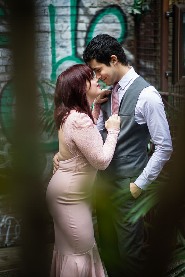 engaged couple poses by entrance to nomo soho hotel in nyc