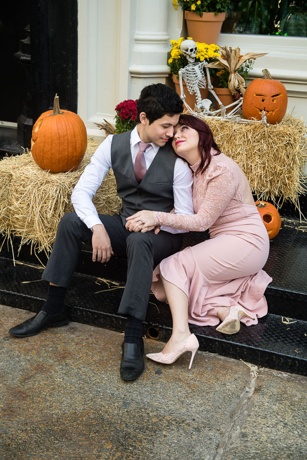 halloween themed engagement session in nyc with pumpkins and hay