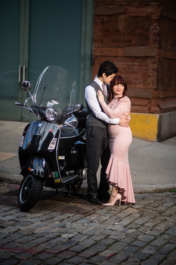 engaged couple poses by vespa scooter in tribeca nyc