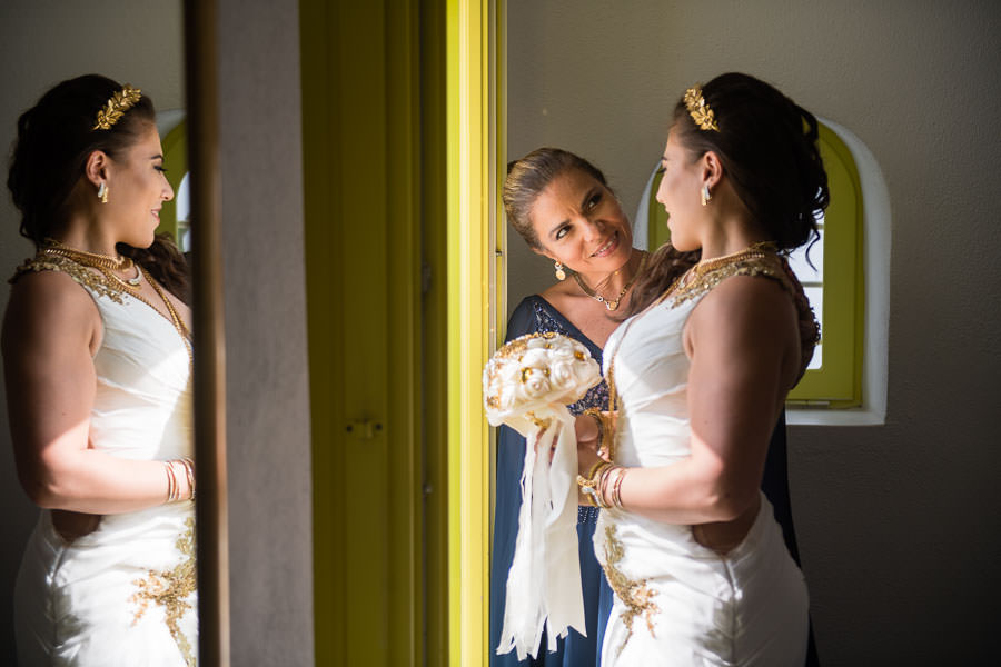 bride and her mom getting ready in diamond rock villa santorini