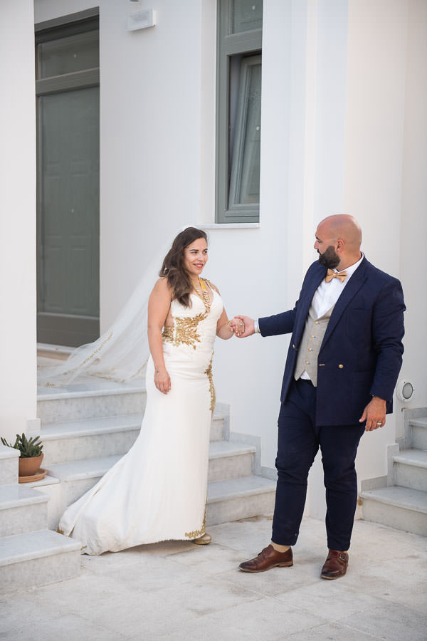 wedding couple poses for destination wedding in santorini, greece