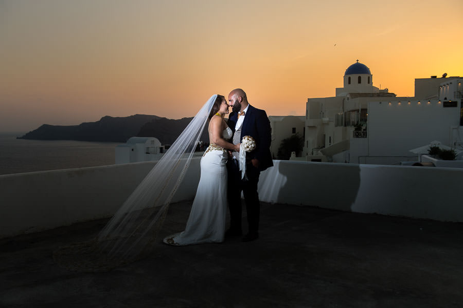 bride and groom at sunset destination wedding in santorini, greece