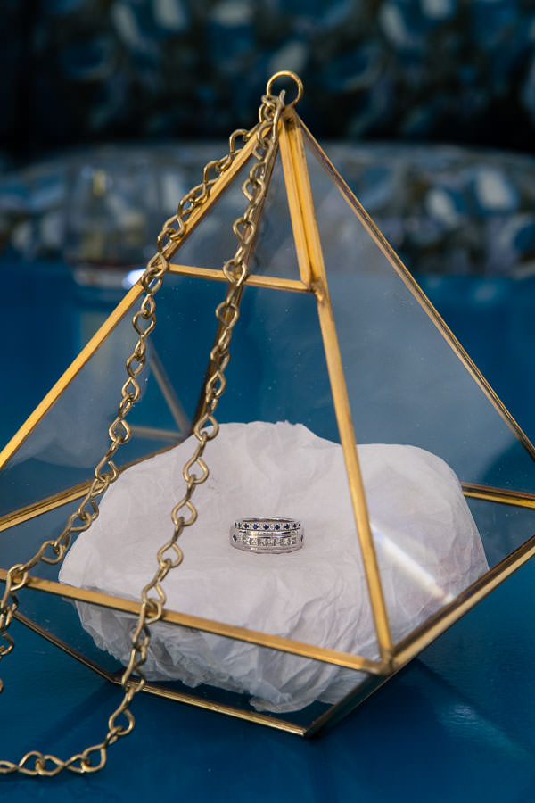 close up of wedding rings in pyramid shaped box