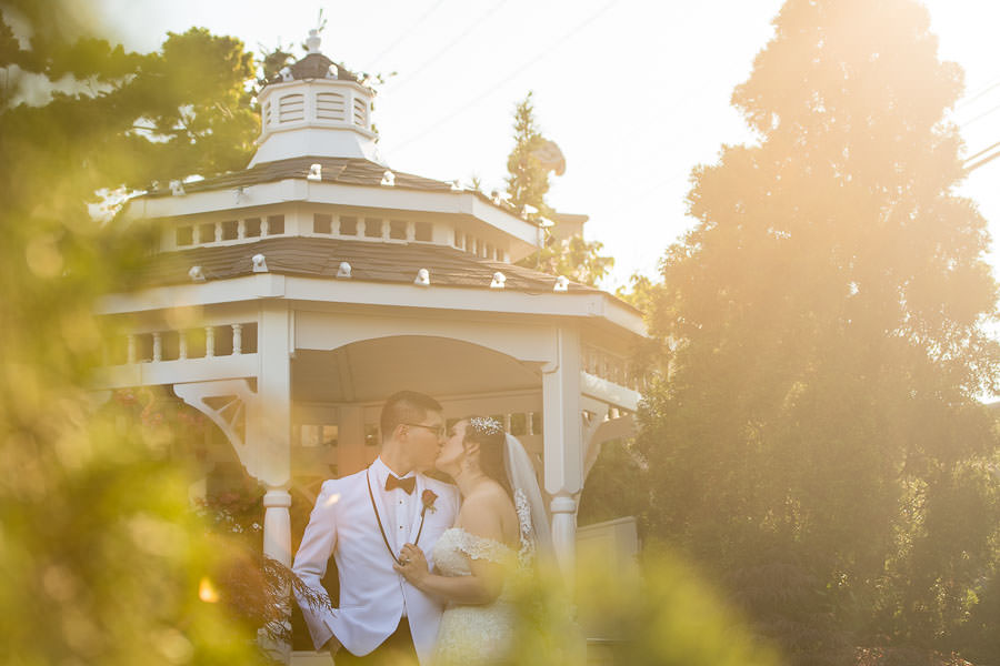 bride and groom at jericho terrace gazebo at sunset