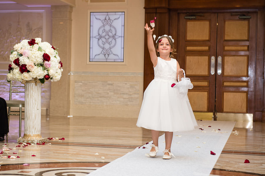 flower girl throwing petals during procession at jericho terrace wedding